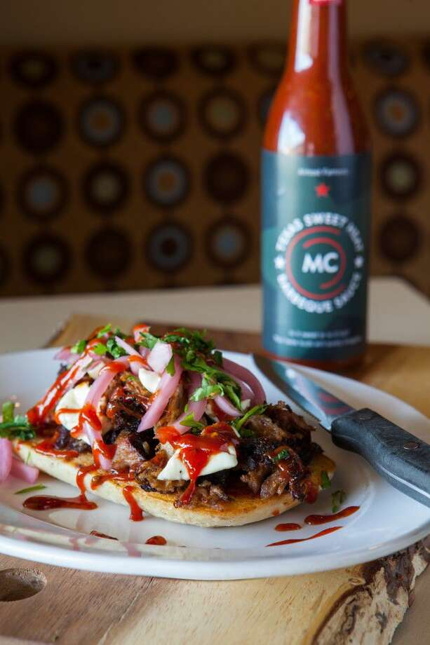 MC Barbeque & Southern Kitchen at Main Street America focuses on its own distinct barbecue recipes combining southern favorites with smoke. Photo: Photographer