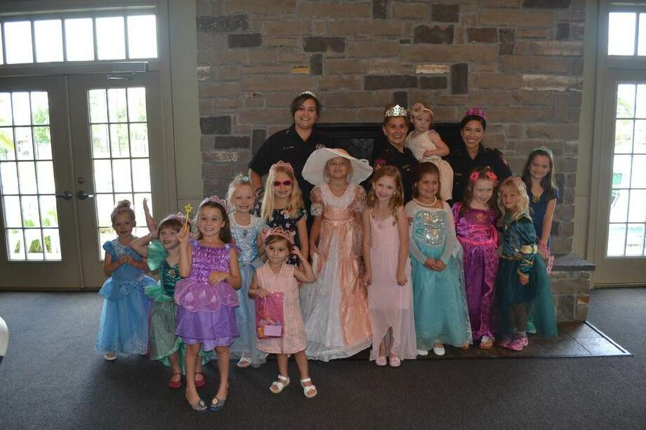 "Deputies with Harris County Precinct 4 join area princesses to teach them the rules of ""stranger danger."" Photo: Submitted Photo"