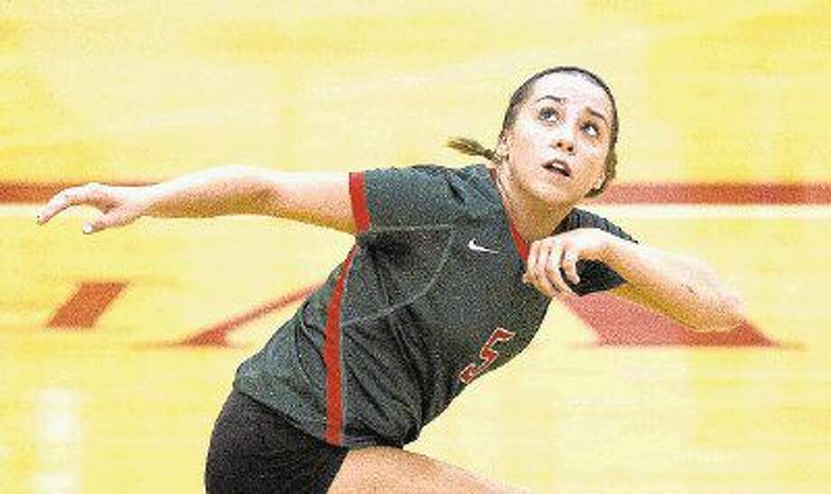 The Woodlands' Mia Primavera watches her pass fly though the air during a high school volleyball game. The Woodlands rallied from two sets down to defeat Katy in five sets. Photo: Jason Fochtman