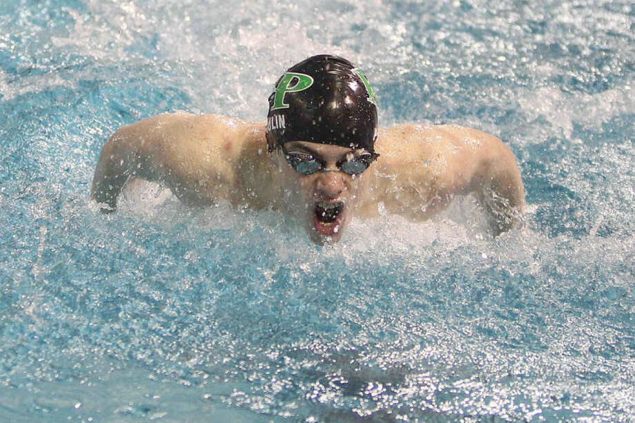 Kingwood Park's Sam Poulin competes in the prelims of the boys 100-yard butterfly at the UIL Swimming and Diving State Championships in Austin Friday. Photo: Jason Fochtman