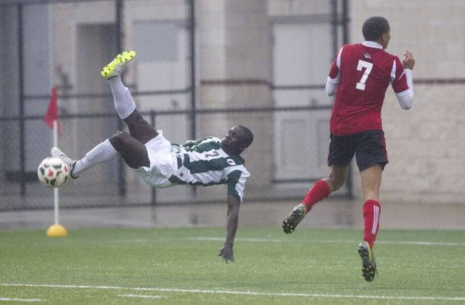 The Woodlands midfielder Buba Jobe attempts a bicycle kick during a Region II-5A bi-district playoff match against Westfield on Thursday at Woodforest Bank Stadium in Shenandoah. Jobe missed the shot but finished the half with a pair of goals and an assist as the Highlanders defeated the Mustangs 5-1. To view or purchase this photo and others like it, visit HCNpics.com.