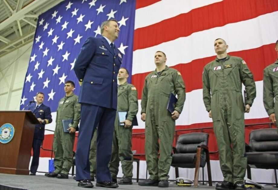 """The U.S Coast Guard Air Station Houston hosted an anniversary ceremony to commemorate 50 years of service at Ellington Field on Friday (March 7). At the close of the anniversary celebration, Admiral Cook and Commander Langum honored seven Coast Guard service members with Air Station Houston's First Life Saved Certificates. """"At Air Station Houston, Coast Guard Aviators are presented a certificate commemorating the successful completion of their first life saved,"""" Admiral Cook said. """"For us, as Coastguardsman and aviators, our First Life Saved is a watershed event. It is the culmination of thousands of hours of training and reminds us of why we chose to Serve."""" Photo: KRISTI NIX"""