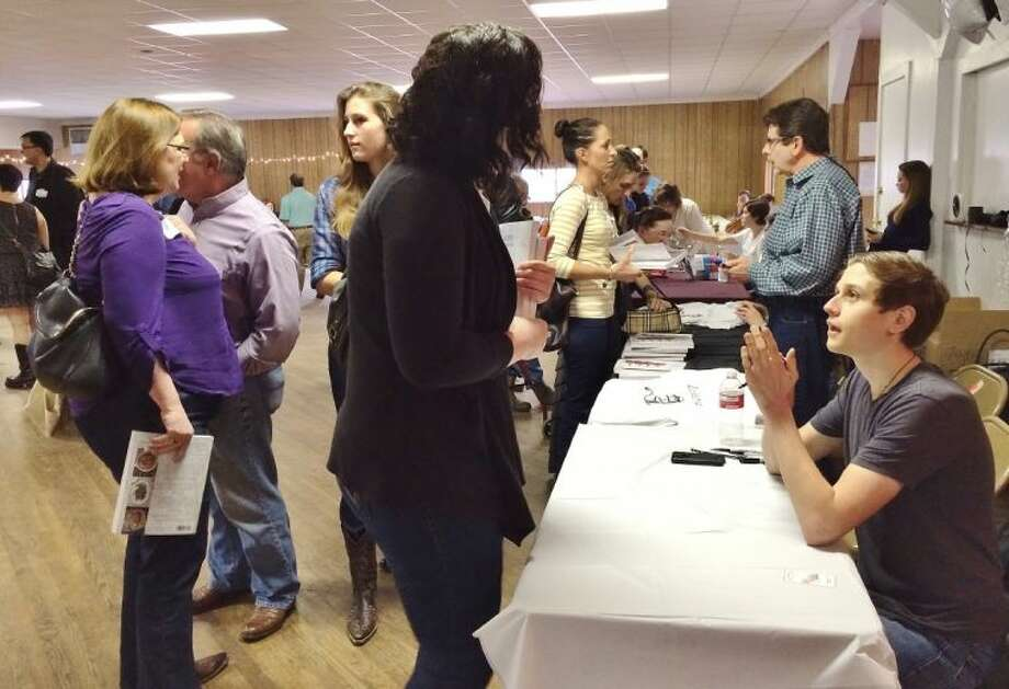 Joshua Weissman signs copies of his new book, The Slim Palate Cookbook, at a book release party in Brenham.