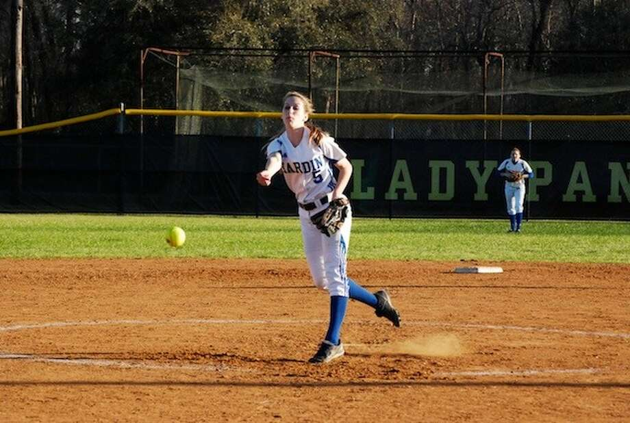 Shayla Fisher (5) pitched the Thursday, March 6, game against visiting Buna. Photo: CASEY STINNETT / Houston Community Newspapers, 2014