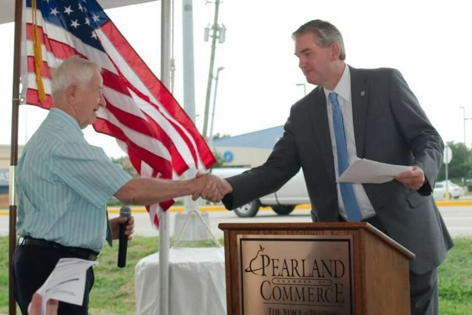 Texas Representative Ed Thompson introduces Pearland Mayor Tom Reid during a ceremony to celebrate the near completion of improvements to State Highway 35 in Pearland Friday, Jul. 18. Photo: KIRK SIDES
