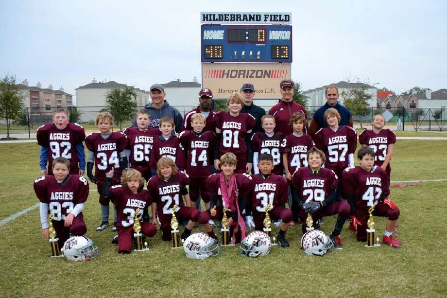 Team members include kneeling, from the left, Samuel McGuire, Eli Gebhard, Nick Gebhard, Andrew Buettgen, Desmond Rubio, Gunther Blencke and Franco O'Malley. Middle row, Will Jenkins, Jack Keeler, Noah Johnson, Bennett Connelly, Wyatt Hansen, James Stanton, Colin Mulcahy, Rex Petrulis, William Barr and Hudson Gibbs. In back, assistant coaches John Keeler, Lawrence Thomas, Sean Mulcahy, Head Coach Peter Buettgen and Assistant Coach David Gibbs.