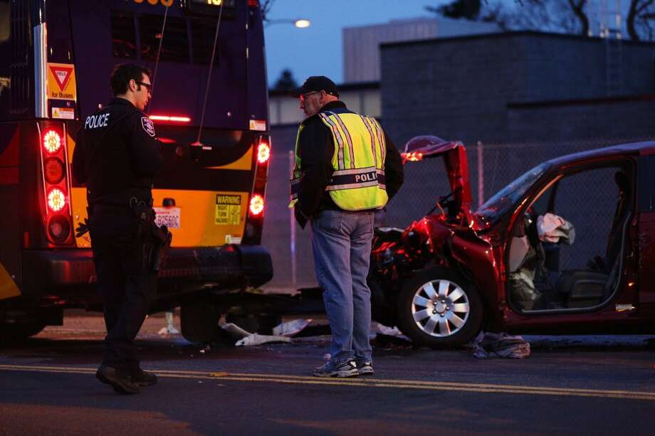 Investigators examine the scene of a crash between a car and a Metro bus on Capitol Hill, March 8, 2016. Photo: GRANT HINDSLEY, SEATTLEPI.COM