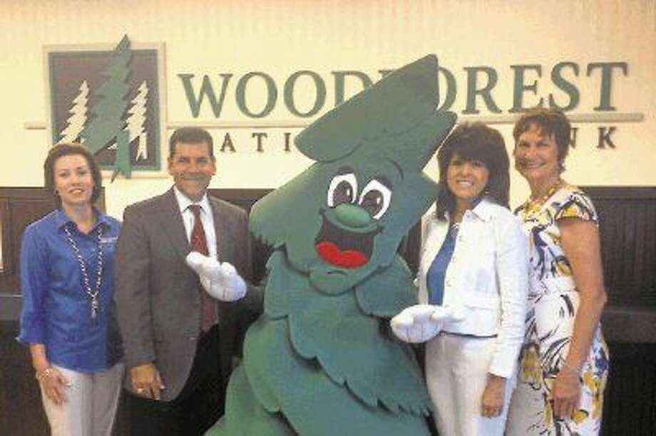 Pictured from left to right are Amber Crupper, Vice President, Woodforest National Bank; Paul Virgadamo Jr., City of Conroe Administrator; Barkley, the official mascot of Woodforest National Bank; Patricia Brown, Sr. Vice President, Woodforest National Bank and Linda O'Dell, Branch Manager of Downtown Conroe branch of Woodforest National Bank.