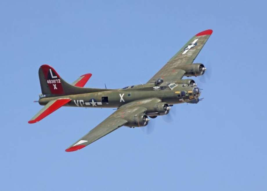"""The tour culminates at Ellington, which will include six World War II military aircraft, including a C-47 Skytrain transport referred to as """"Gooney Bird"""", the """"only flying example"""" of an SB2C Helldiver bomber and the B-17 Flying Fortress."""