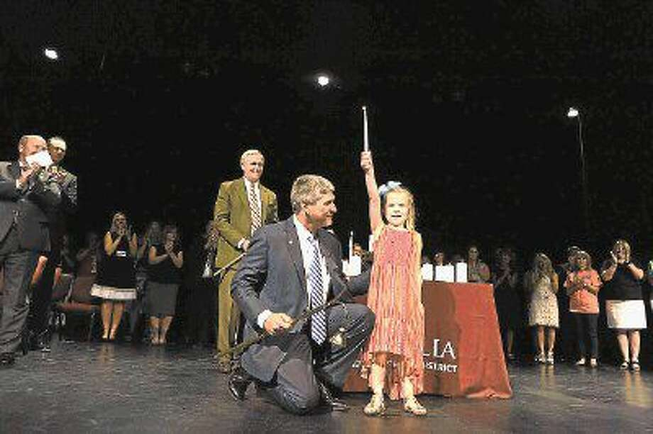 Magnolia Independent School District Superintendent Dr. Todd Stephens and Smith Elementary student Kynsley Swonke kick off the 2016 school year by lighting the candle of knowledge during MISD's Convocation on Aug. 12. Photo: Tony Gaines