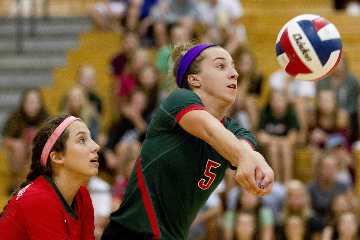 The Woodlands libero Mia Primavera returns a serve during the first set of a non-district volleyball game Tuesday at The Woodlands High School. Go to HCNpics.com to purchase this photo and others like it.