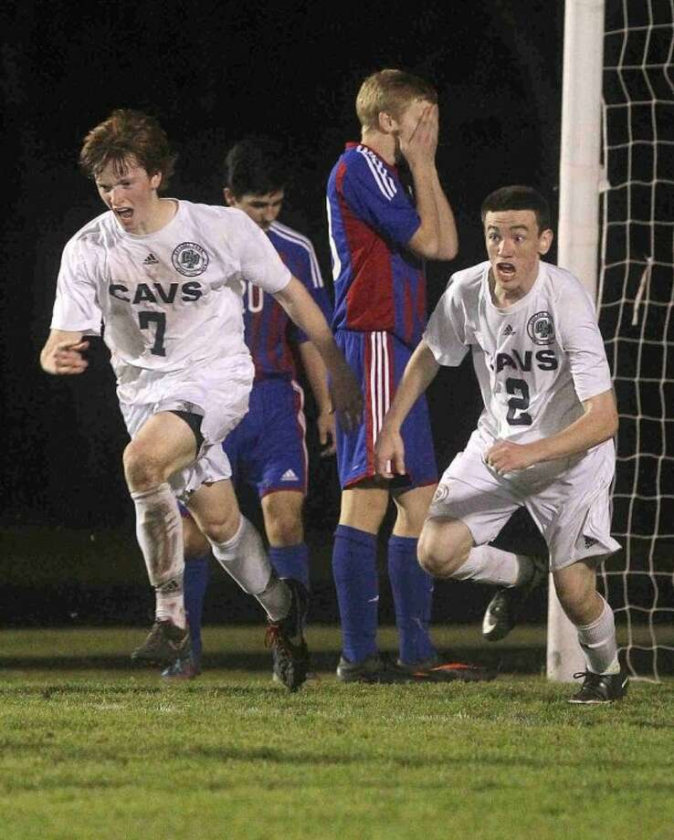 College Park's David Beckman (7) and Patrick Kelly (2) celebrate after Beckman's game-winning goal in the second period during a high school boys soccer game Friday. Beckman's goal broke a 2-2 tie to give College Park a 3-2 win against Oak Ridge. To view or purchase this photo and others like it, visit HCNpics.com.