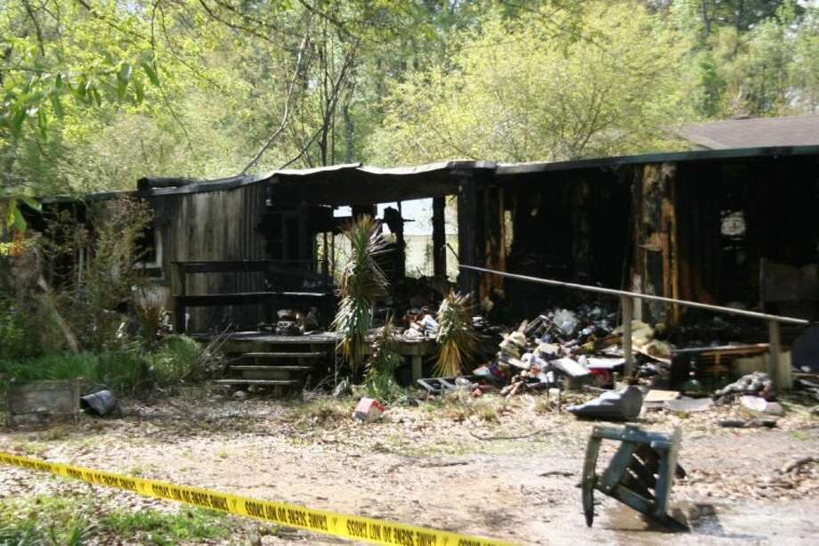A mobile home at 26531 Short Street in Patton Village was destroyed in a fire Monday morning. Photo: Nate Brown