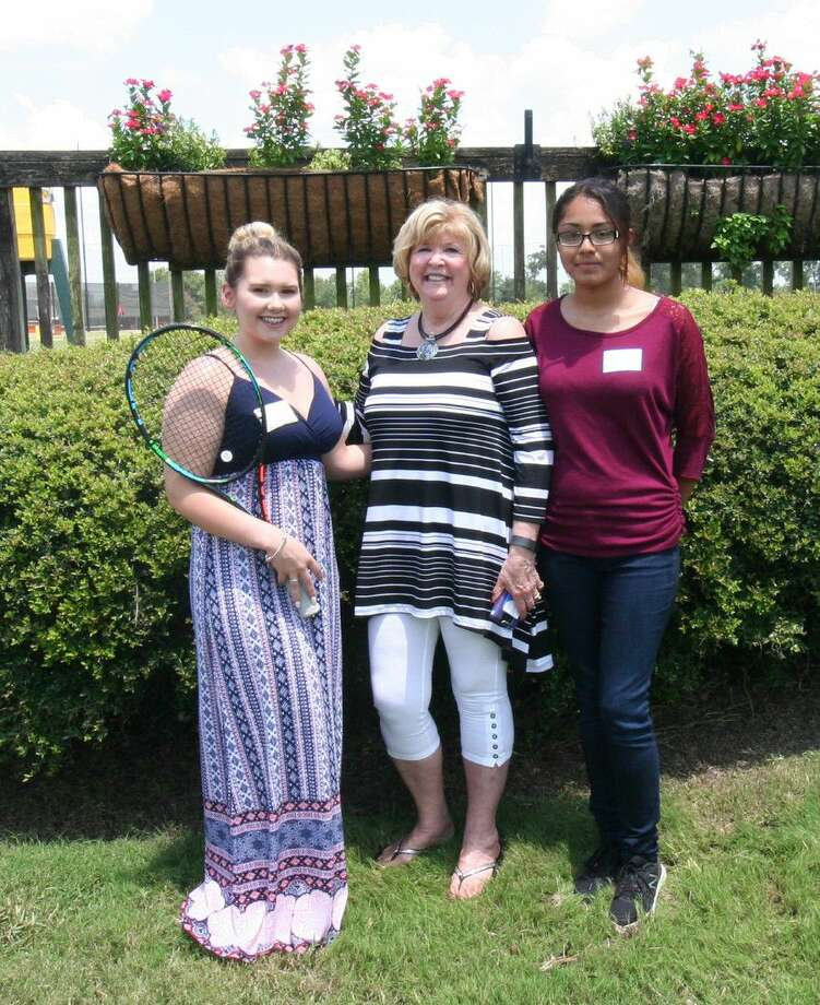 Sherri Hinson, left, and Angelica Calvillo, right, received a Steve Wolford Scholarship, given in memory of the Magnolia resident. Nadia Kiani, not shown, also received a Wolford scholarship. Center is HTA Director Cheryl Hultquist Horvath. Photo: Submitted Photo