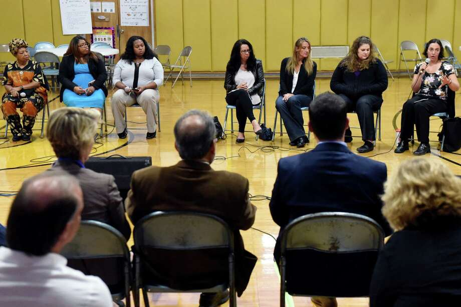 Heather Allen of Hoosick Falls, left, speaks during a discussion on water quality with local mothers and mothers from Flint, Mich. on Thursday, Oct. 6, 2016, at St. Mary's Academy in Hoosick Falls, N.Y. Joining her, from left, are Darlene McClendon, Lashaya Darisaw and Danika Jackson, all of Flint, Mich.; Michelle Baker and Laureen Hackett of Hoosick Falls; and Emily Marpe of Petersburgh. (Cindy Schultz / Times Union) Photo: Cindy Schultz / Albany Times Union