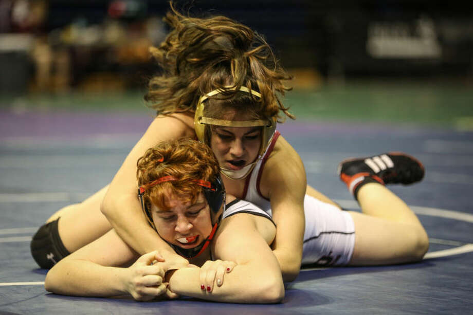 Cy Woods' Taylor Alva wrestles Bellaire's Darla Allen during the UIL 4A and 5A Region III Wrestling Championships on Saturday, Feb. 1, 2014, at the Berry Center. To view or purchase this photo and others like it, go to HCNPics.com. (Michael Minasi / HCN) Photo: Michael Minasi