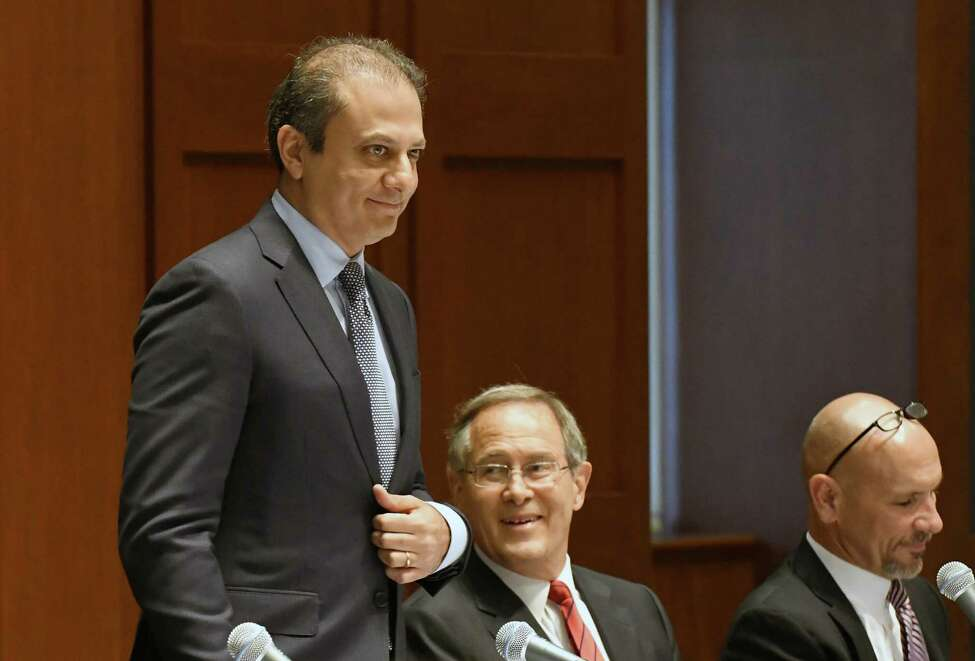 US Attorney Preet Bharara, left, takes part in a panel discussion during an event titled