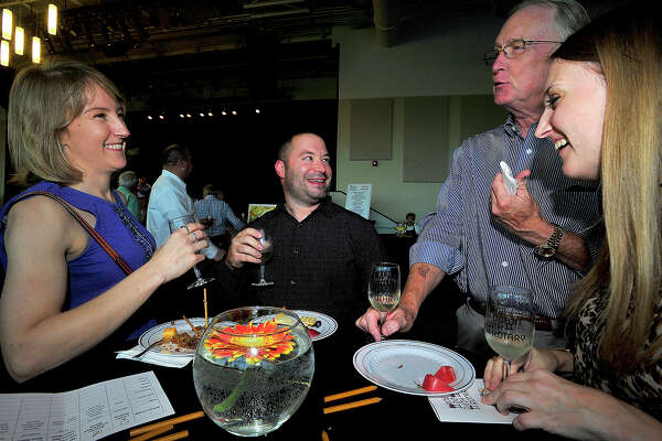 From left, Maureen and Mike Schneider and Mark and Michelle Alsup enjoy the evening at Wine Down with Rotary held at the Event Centre Thursday night. This year's second annual event celebrates the Centennial of the Rotary Foundation, and proceeds from the fundraiser will go toward the organization's local and world benefit projects. In addition to wine samplings, hors d'oevres and mini desserts were offered to tempt the palate, while musical entertainment, silent auction and raffle items rounded out the activities.  Photo taken Thursday, October 6, 2016 Kim Brent/The Enterprise