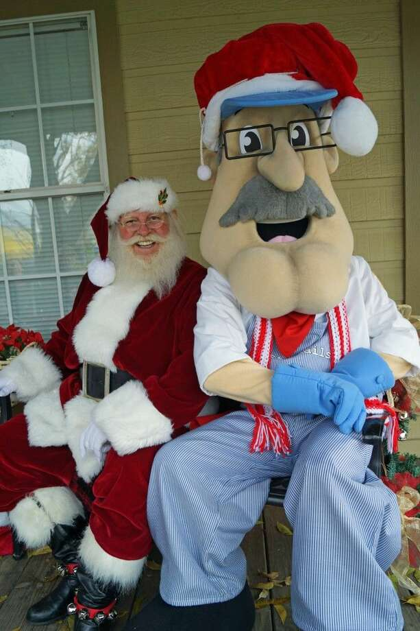 Santa and Rusty Rails, the official tourism and festivals mascot of Tomball. Photo: City Of Tomball