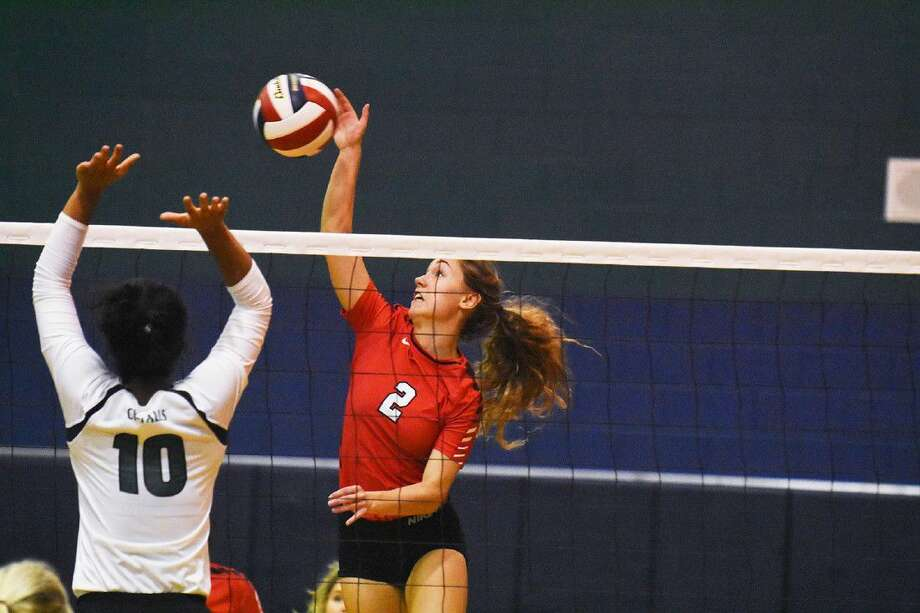 Tomball's Faith Allen goes up for a kill against Cy Falls' Taylor Williams during the Katy/Cy-Fair Nike Invitational Saturday. Photo: Tony Gaines