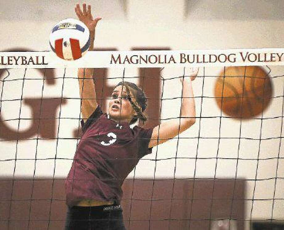Magnolia's Ally Meyers (3) hits the ball during a high school volleyball game against Montgomery on Tuesday, Aug. 9. Photo: Michael Minasi