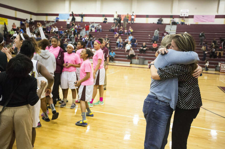 Summer Creek coach Angie McDonald hugs Humble ISD athletic director Krista Malmstrom as the Lady Bulldogs celebrate after Summer Creek's victory over Barbers Hill on Feb. 1, 2014, at Summer Creek High School. (Photo by ANDREW BUCKLEY/The Observer) Photo: ANDREW BUCKLEY