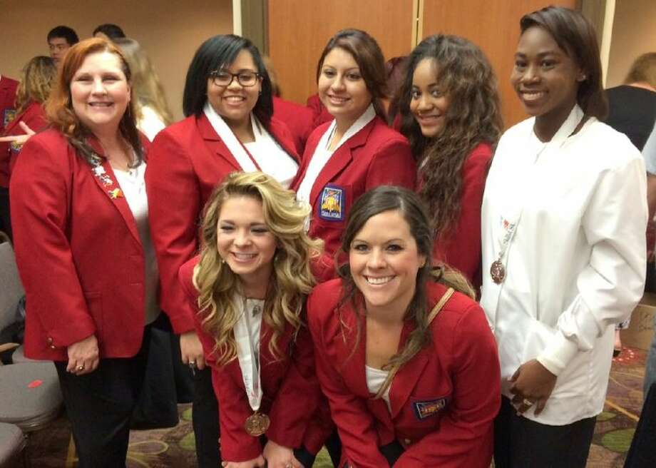 Pictured are (back, from left) Pandora Freestone (San Jacinto Community College cosmetology teacher), Shyla Broussard, JoAnn Castro, Antonia Spriggins and Mikaela Johnson and (front, from left) Kailie Ruffino-Montoya and Laura Dunham (DHS teacher). Photo: Courtesy Pearland ISD