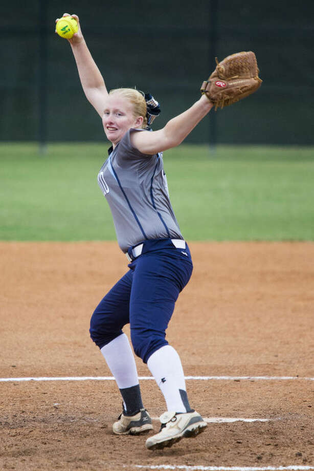 Kingwood's Ashley Johnson pitches during Kingwood's playoff matchup against Oak Ridge on May 8, 2014, at Summer Creek High School. Photo: ANDREW BUCKLEY