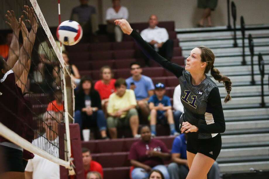 Montgomery's Mallory Talbert (11) hits the ball during a high school volleyball game against Magnolia on Tuesday. To view more photos from the game, go to HCNPics.com.