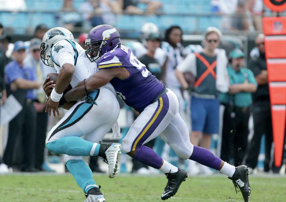 Carolina Panthers' Cam Newton (1) can't get out of a sack by Minnesota Vikings' Everson Griffen (97) during the second half in Charlotte, N.C., on Sept. 18, 2016. Photo: Bob Leverone /Associated Press / FR170480 AP