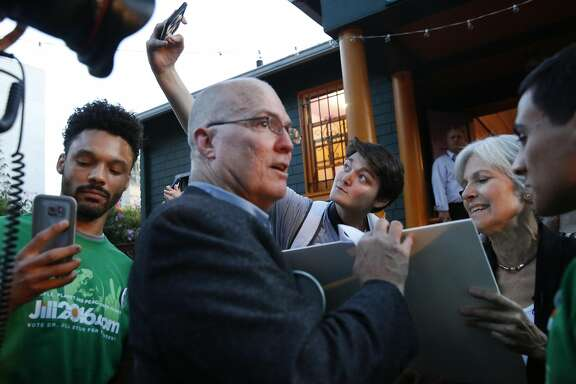 Jonathan Dupin, center, takes a selfie as Green Party presidential candidate Jill Stein signs her autograph with the help of David Cobb after a rally in Humanist Hall Oct. 6, 2016 in Oakland, Calif.