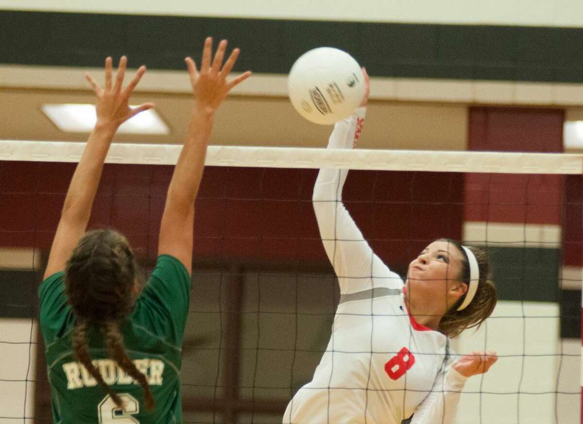 Porter's Megan Kelly goes for a kill against Bryan Rudder in at Porter High School on Tuesday.