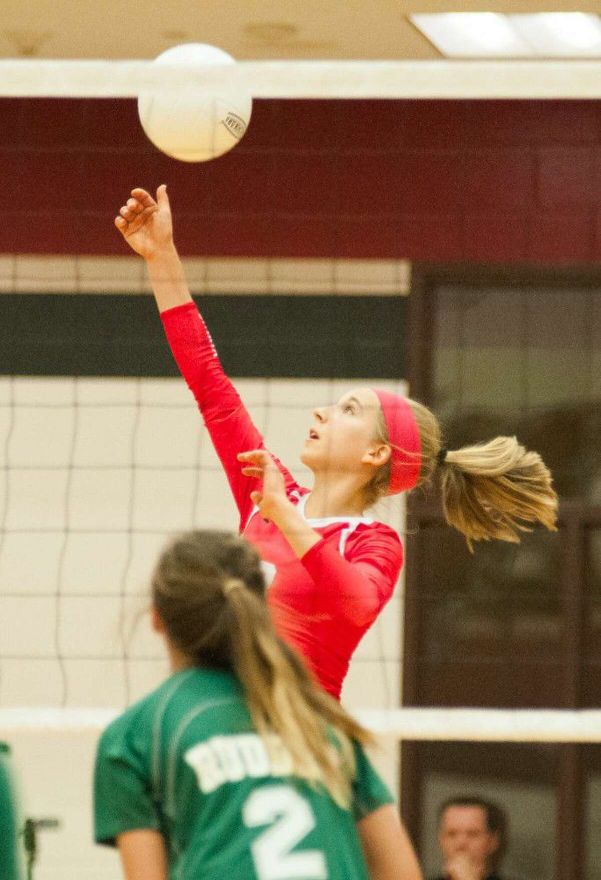 Porter's Laura Tonchina hits the ball during an offensive set against Bryan Rudder in at Porter High School on Tuesday.