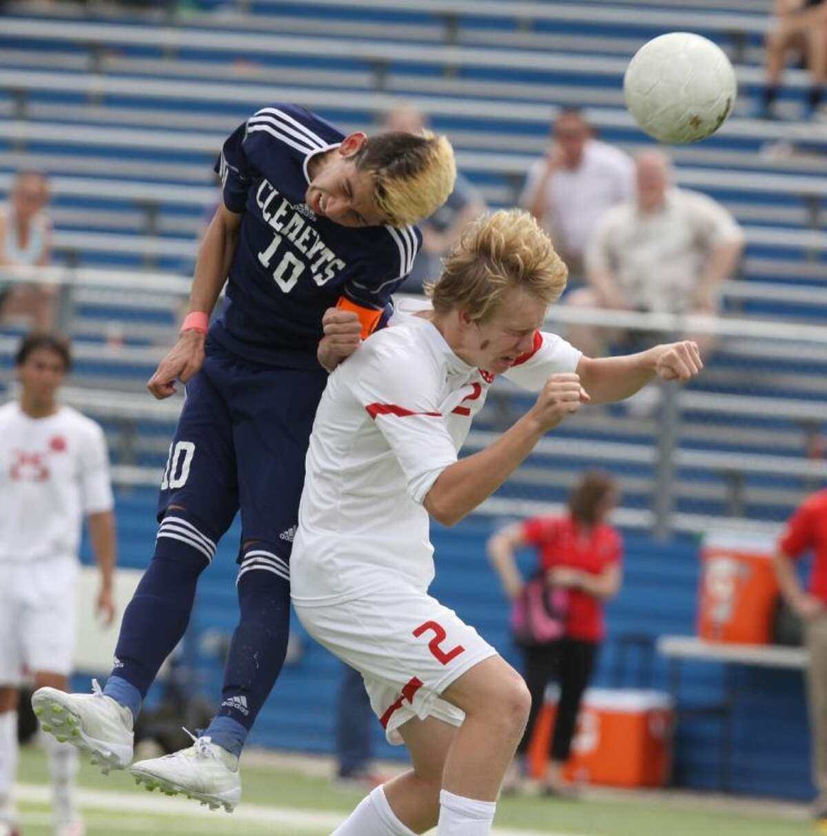 Clements' Trinidad Luna wins a ball against Coppell's Drew Brinda during the 5A Boys State Championship, April 19 at Birkelbach Field in Georgetown. Luna was voted District 23-5A MVP. Visit HCNPics.com for more photos.