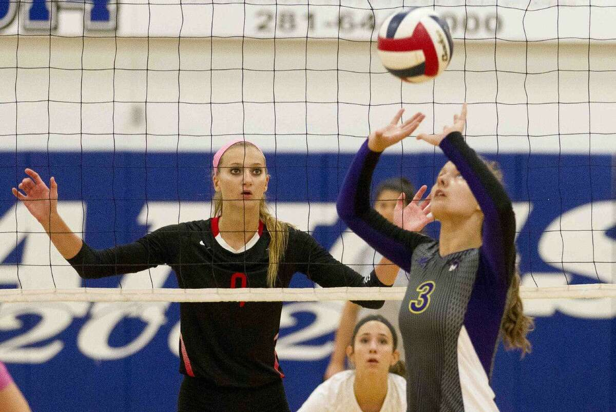 Langham Creek blocker Ashely Lewis watches as Montgomery's Brittany Risner sets the ball in the second set of a volleyball match during the Katy/Cy-Fair Nike Invitational Saturday.