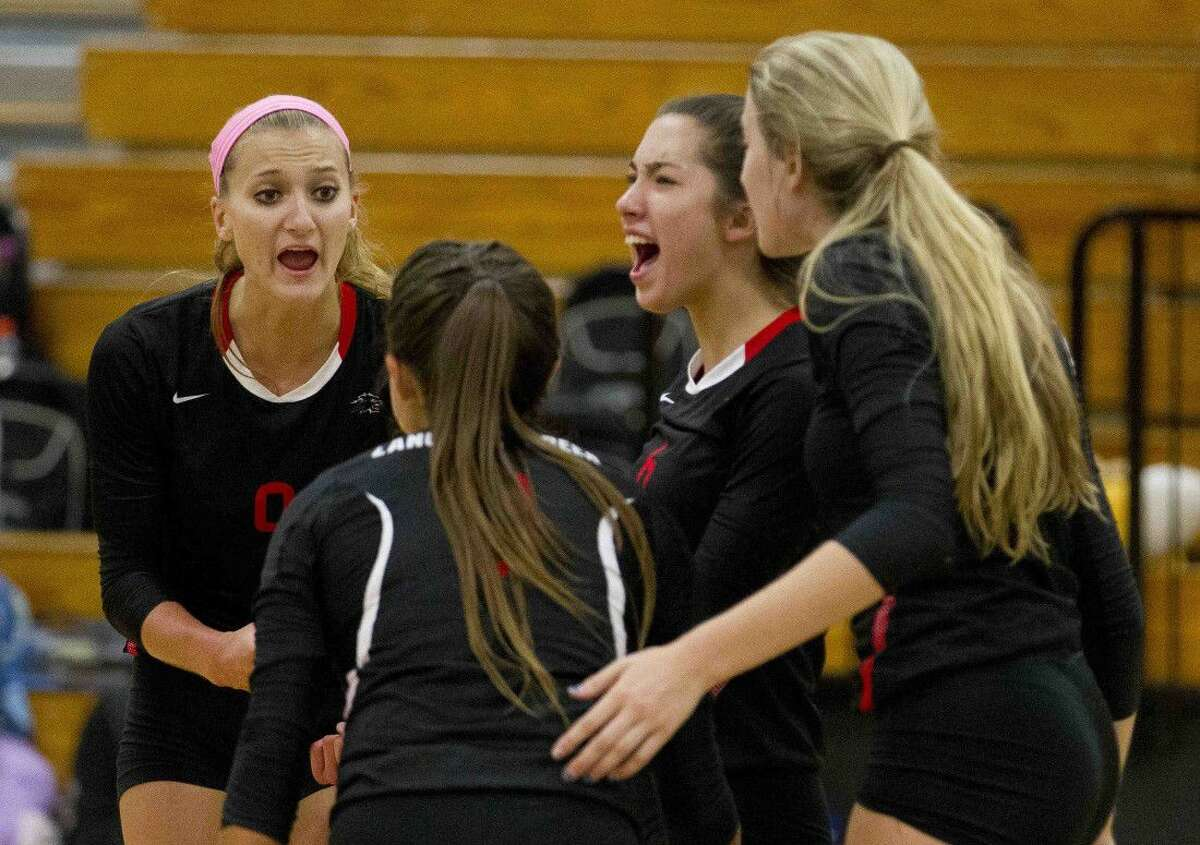 Langham Creek's Janna Skinner, center, celebrates a point in the third set of a volleyball match during the Katy/Cy-Fair Nike Invitational Saturday. Langham Creek secured fifth place in the tournament with a convincing win against Montgomery.