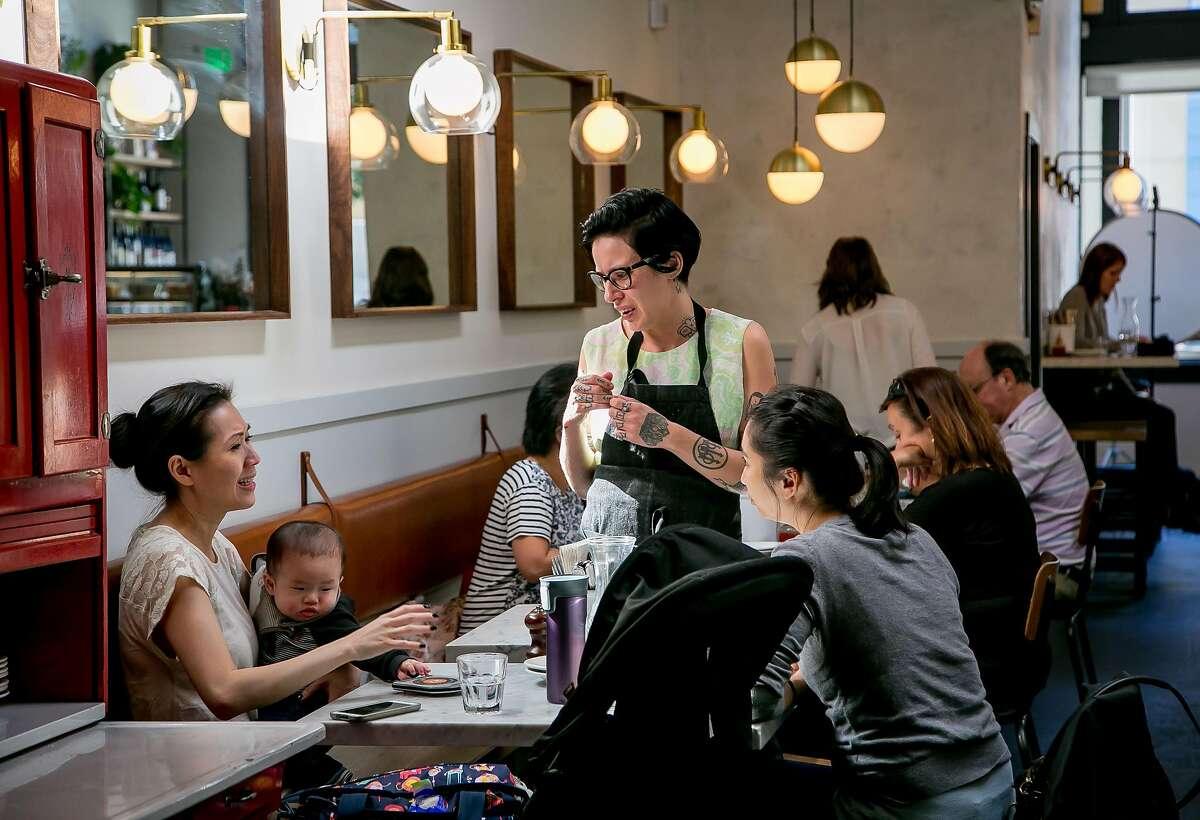 Hallie Kuchar explains the menu to customers at Barzotto.