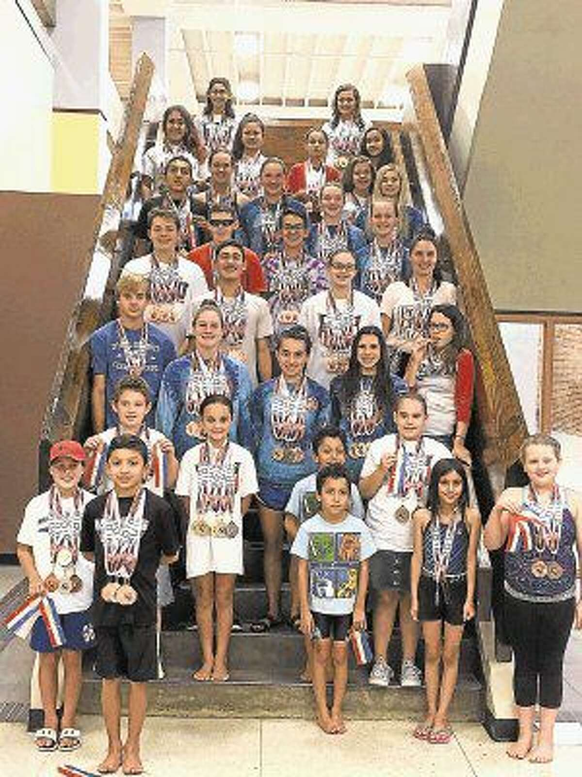The many swimmers who represented Deer Park at the recent AAU Junior Olympics got out of the pool just long enough for a group picture.
