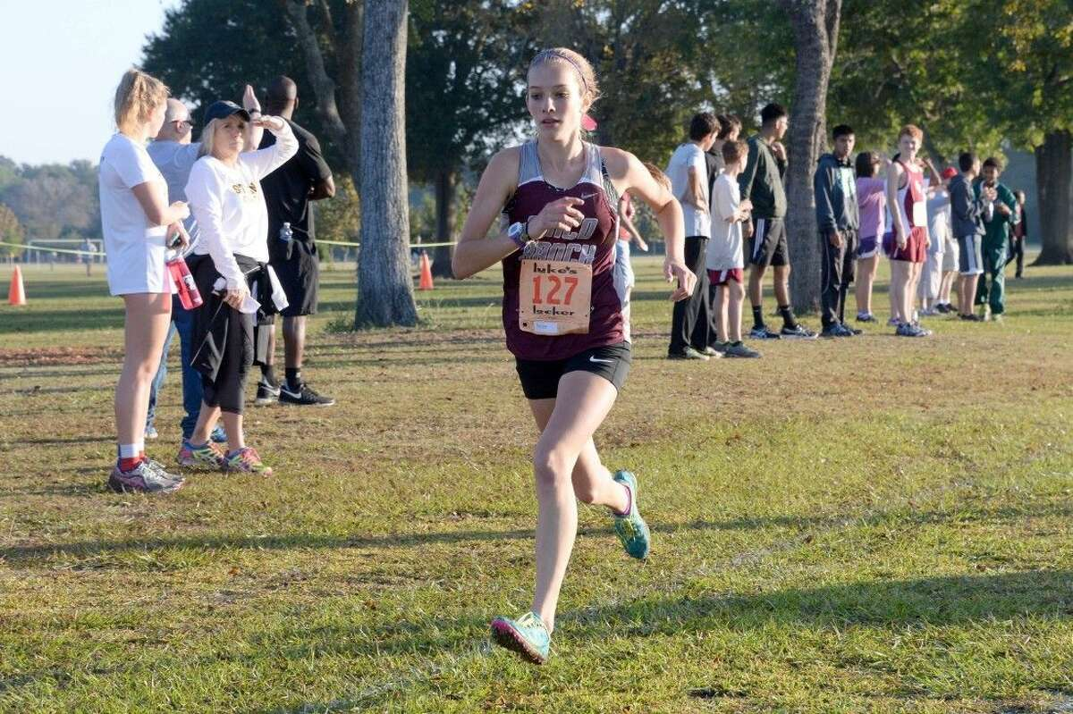Megan Hopper placed 15th to help Cinco Ranch finish second as a team in Region III-6A. The Lady Cougars qualified for the state meet.