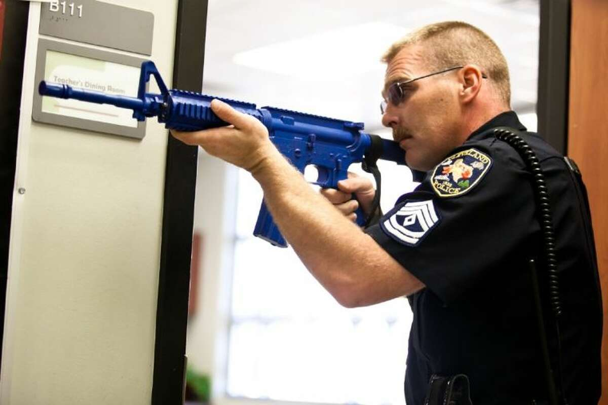 Sgt. David Edwards of Cleveland Police Department partcipates in an active shooter drill at Cleveland High School in 2013. CISD is planning another drill for Aug. 19.