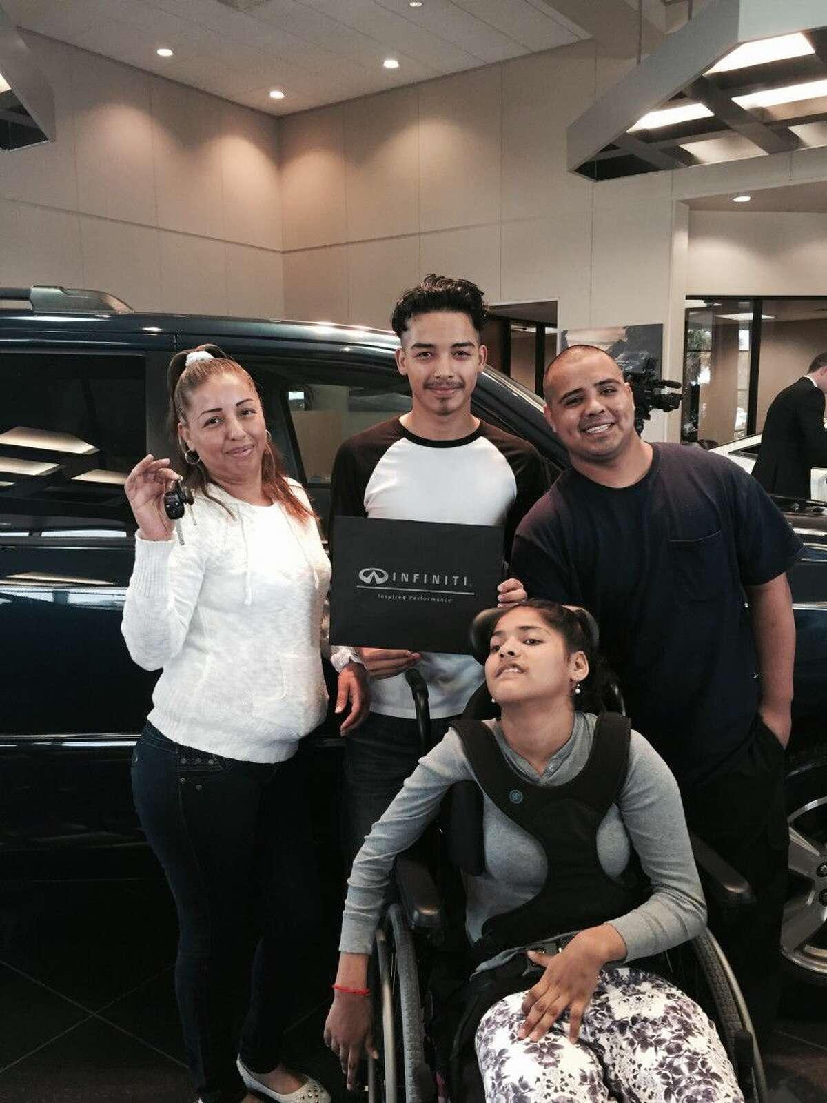 The Hernandez familty getting the keys to their Honda Pilot. Socorro, Jaime, Pablo and Angela Hernandez.