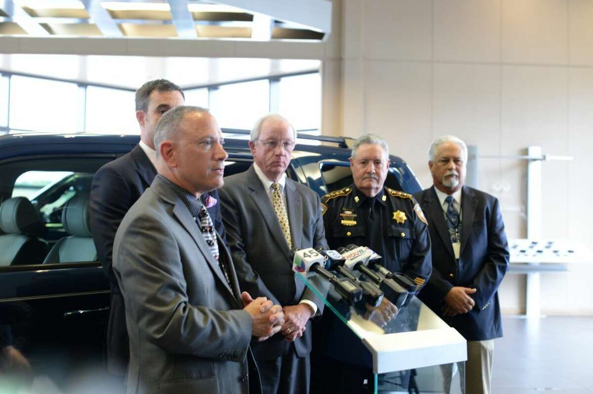 Pictured (from left) are Dep. Thomas Gilliland with the Harris County Sheriff's Office, Billy Frank of CLear Lake Infiniti, Mike Sullivan with the Harris County Tax Office, Sheriff Ron Hickman and Chief Bill Smith.