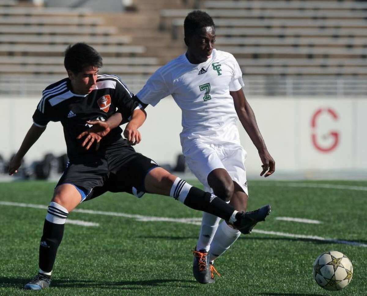A Dobie player battles a Cy-Falls player during last weekend's Pasadena Cup. The two were competing in the Black Group.
