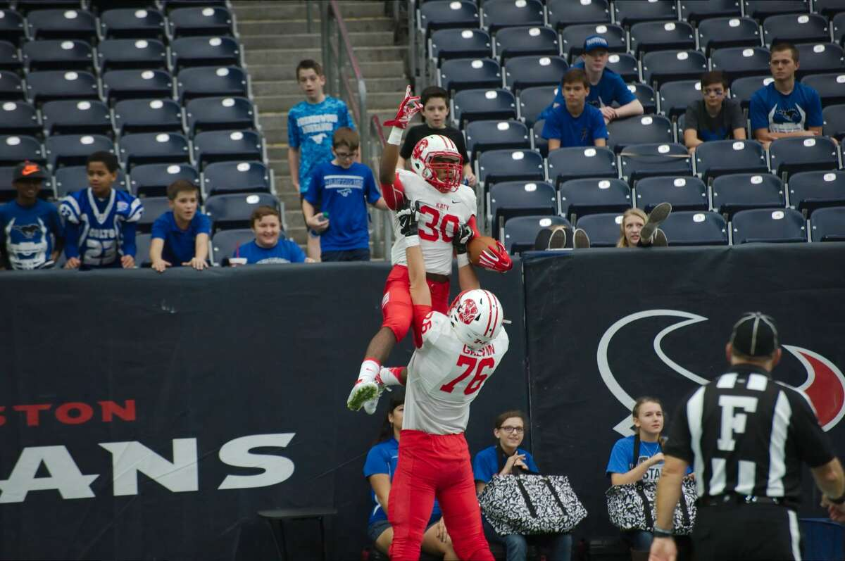 Katy's Deondrick Glass (30) and Connor Galvin (76) celebrate a touchdown against Friendswood in the 2015 regional semifinals. The Tigers are ranked No. 1 in the state entering 2016.