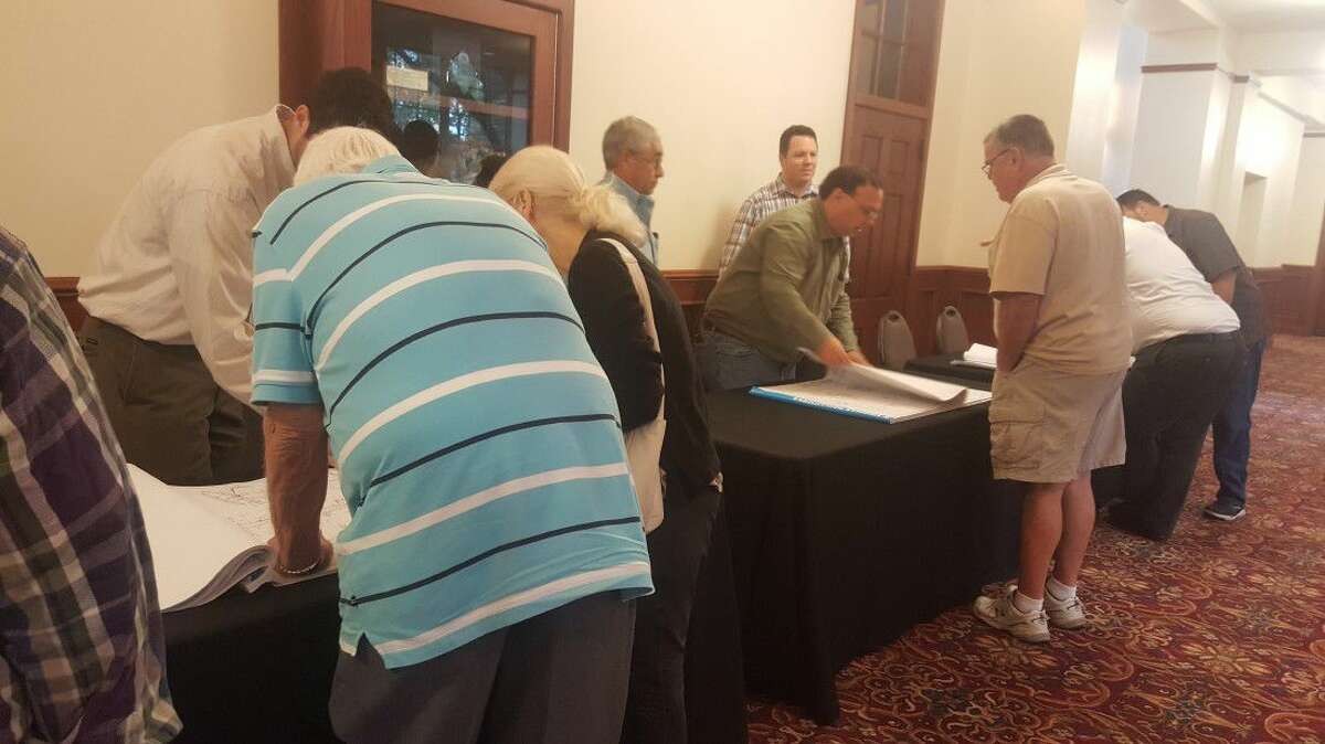 Humble citizens speak with contractors and engineers about how the 2016 Concrete Pavement Improvement Project will affect them during an Humble town hall meeting at Bender Performing Arts Center Tuesday, Aug. 16.