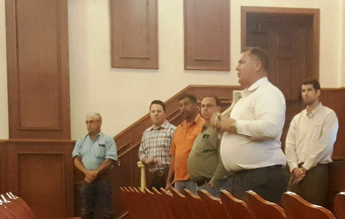 John Rudloff, project design engineer from ARKK Engineers introduces Triple B contractors who will be carrying out construction for the 2016 Concrete Pavement Improvement Project during an Humble town hall meeting at Bender Performing Arts Center Tuesday, Aug. 16.