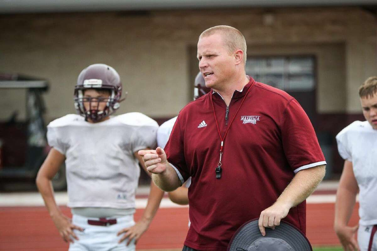 Magnolia coach Sterling Doty gives direction during football practice on Tuesday at Magnolia High School.