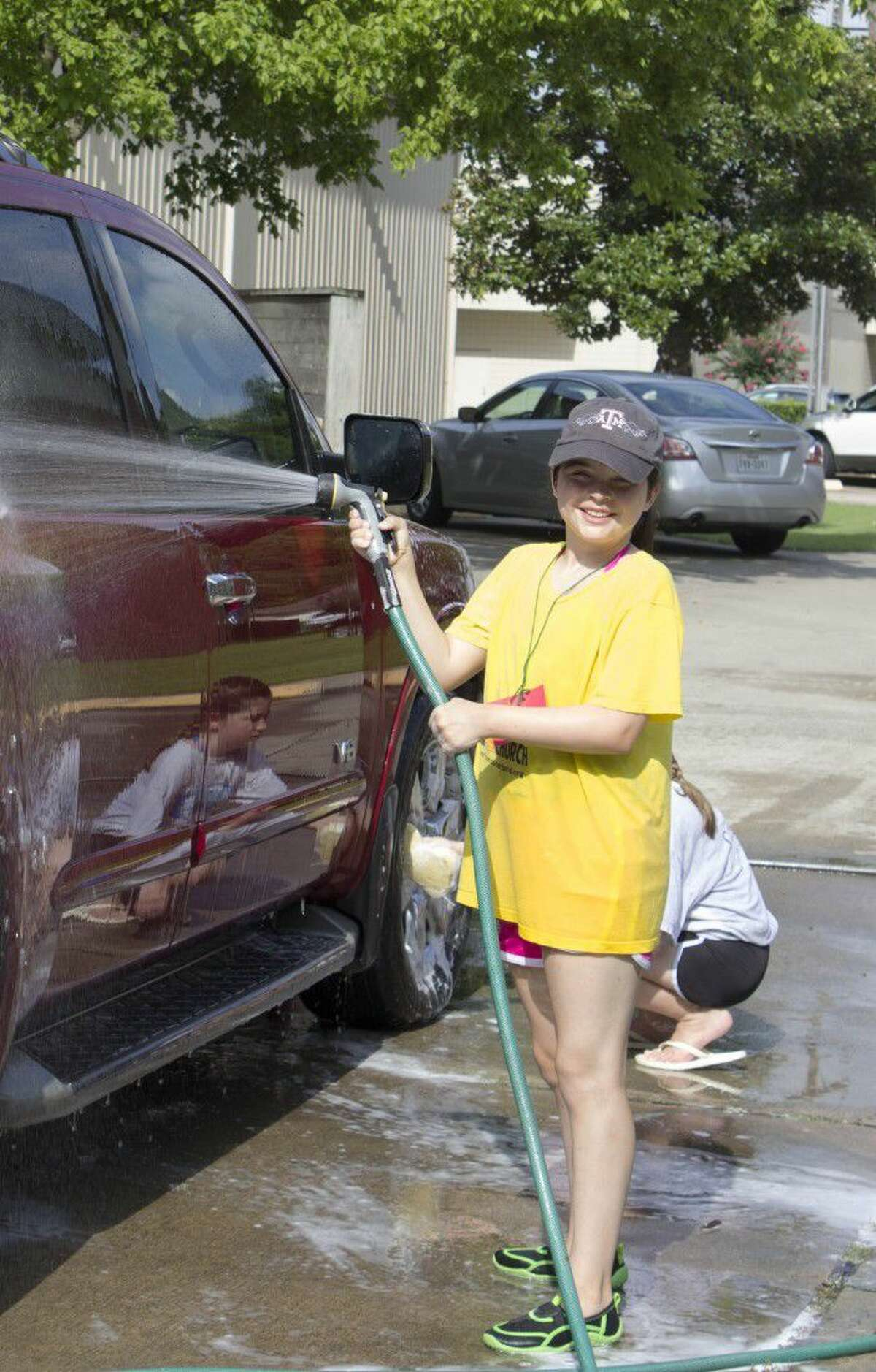 Rinsing the washed cars was also a good way to cool off.