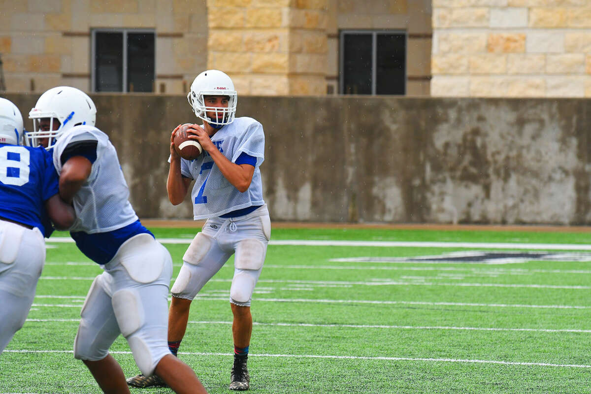 Cypress Creek junior quarterback Mateo Renteria prepares to pass in a practice at Cy-Fair FCU Stadium Tuesday, Aug. 16, 2016. Renteria has as much responsibility within Cypress Creek's offense as any other player in 17-6A, but he relishes the opportunity.