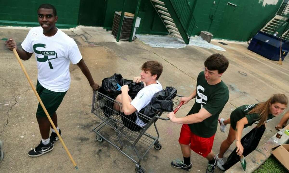 Resourceful students repurpose a shopping cart into a trash pickup system Saturday at the Big Day.